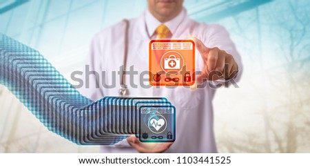 Unrecognizable physician accessing the most recent entry block in a healthcare blockchain. Health care data management concept for distributed virtual ledger technology, health information exchange. #1103441525