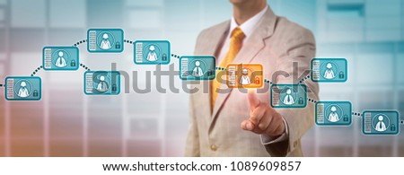 Unrecognizable recruitment agent choosing a female candidate via a block record in an integrated blockchain system. Information technology concept for digital database recorded in a public ledger.