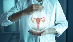unrecognizable reproductologist holding a holographic model of the uterus and ovaries. Reproductive system, Infertility Treatment Concept