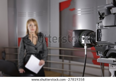 unrecognizable television news reporter in front of the video camera in studio in live transmission