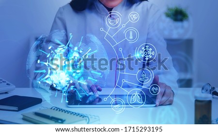 Unrecognizable woman doctor using tablet in blurry office with double exposure of covid 19 coronavirus treatment interface. Concept of 2019 ncov vaccine and treatment. Toned image