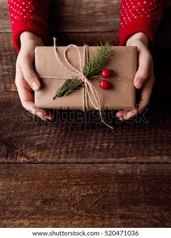 Unrecognizable woman holding Christmas present. Copy space. #520471036