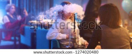 Unrecognizable woman in the night club or bar smoke a hookah or shisha. The pleasure of smoking. Sexy smoke with vape. #1274020480