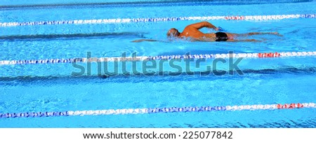 Unrecognized person swim in swimming pool. Background texture. concept photo water, sport, swimming.