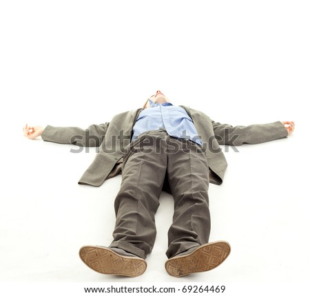unrecognized young man lying on the floor, businessman feet of a dead body