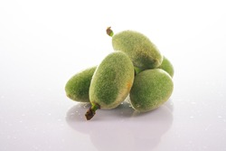 unripe almonds on white background