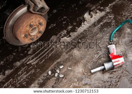 unscrewing a car wheel, car wheel repair #1230712153