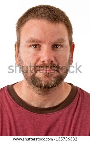 Unshaven Caucasian male facing forward