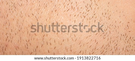 Unshaven stubble on a man's face.Part of an unshaven male face.Photo of male bristles. Сток-фото ©