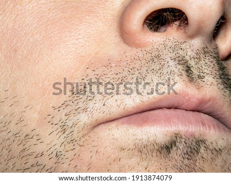 Unshaven stubble on the male face around the lips. Сток-фото ©