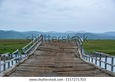 unstable wooden bridge in mongolia