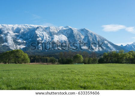 Untersberg mountain in Spring with fresh snow on top #633359606