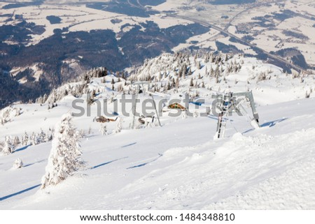 Untersberg Summit.  Looking from the summit of Untersberg mountain in Austria towards a ski lift.  The mountain straddles the border between Germany and Austria. #1484348810