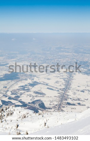 Untersberg Summit.  The view from the summit of Untersberg mountain in Austria.  The mountain straddles the border between Germany and Austria and in the background can be seen the city of Salzburg. #1483493102