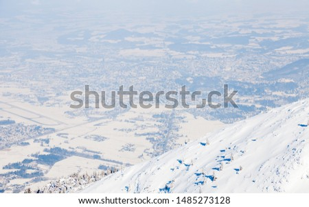 Untersberg Summit.  The view from the summit of Untersberg mountain in Austria.  The mountain straddles the border between Germany and Austria and in the background can be seen the city of Salzburg. #1485273128
