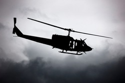 Untitled helicopter flying in the sky photo. Helicopter with no markings. Silhouette shot. Heli with sky background.