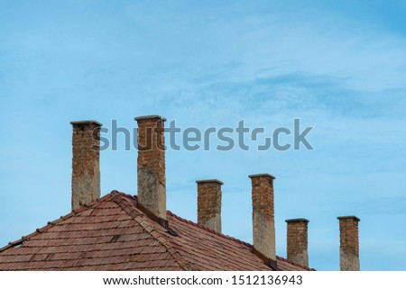 Unused chimneys on old, abandoned factory at sunset in Transylvania, Romania. #1512136943