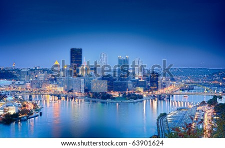 Unusual blue shaded image of Pittsburgh in the evening processed in HDR to highlight the reflections in the river