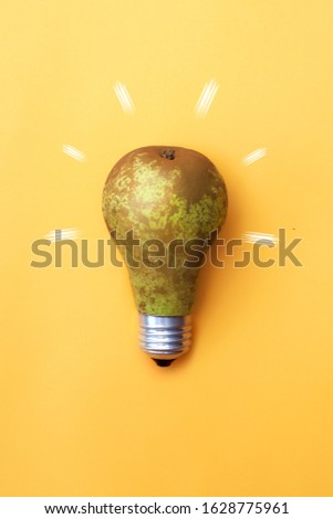 Unusual conceptual photo of a bulb in the form of a pear. The strength of the fruit