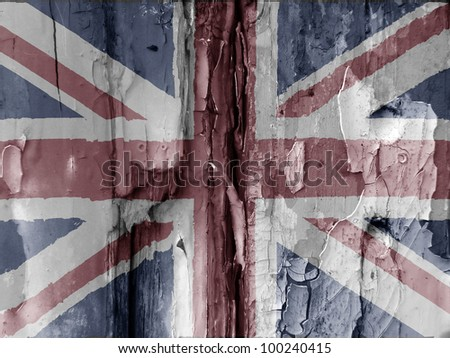 Unusual grunge type image show the British flag overlaid over flaky paint on old wooded door. Faded colors used adds to the effect. Eye catching image has many uses.
