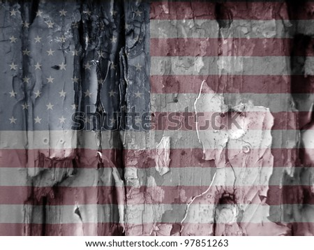 Unusual grunge type image show the US flag overlaid over flaky paint on old wooded door. Faded colors used adds to the effect. Eye catching image has many uses.