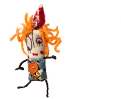 Unusual handmade funny textile doll on white background.