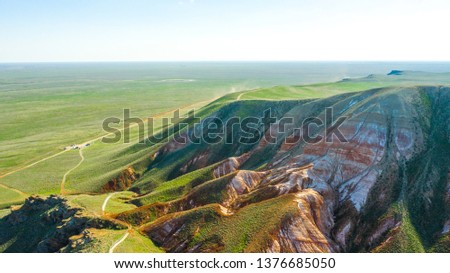 Unusual landscape. Mountain Big Bogdo in the Astrakhan region, Russia. Sacred place for practicing Buddhism. The only unique natural elevation among the steppe areas of the Caspian lowland. #1376685050