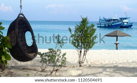 unusual pendant chair on the beach in Thailand near the ocean. concept of success, relaxation, pleasure, relaxation, happiness and relaxation in exotic  #1120504691