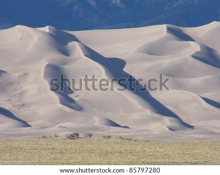 Unusual sand dune formation among the mountains and desert of southwestern Colorado