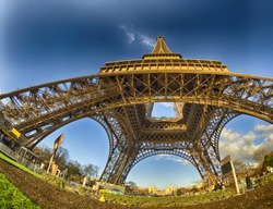Unusual wide angle view inside the center of the Eiffel tower in Paris - France