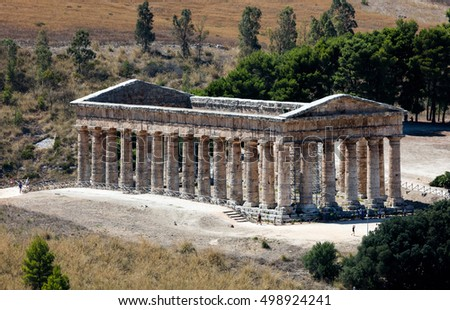 Unusually well preserved Greek Doric temple of Segesta is thought to have been built in the 420's BC by an Athenian architect and has six by fourteen columns on a base measuring 21 by 56 meters. #498924241