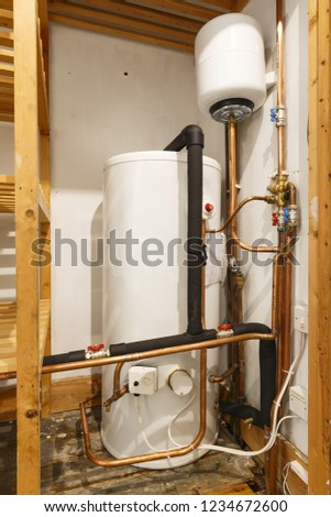 Unvented hot water cylinder and expansion vessel in an airing cupboard. UK plumbing #1234672600