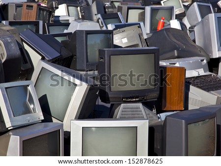 Unwanted televisions piled up for recycling at government collection point