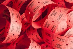 Unwound Messy Roll of Red Tickets Piled Up.