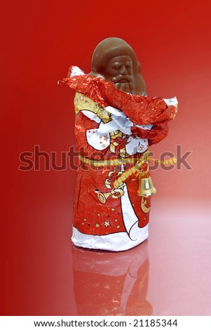 unwrapped chocolate Nikolaus or Santa agianst a red background
