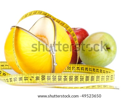 Unzipped melon, apples and measuring tape. Healthy eating concept. Close up.