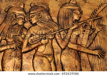 UP CLOSE ARTIFACT OF WOMEN SOCIALIZING IN ANCIENT TIMES