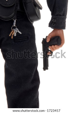up close plastic toy police figure with pistol in hand