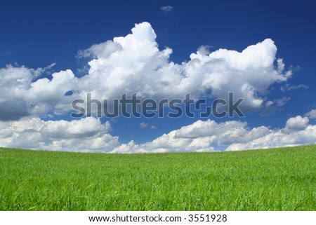 up the hill towards gorgeous sky, focus is set on horizon line