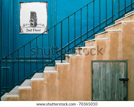Up the stairs to the second floor and blue wall