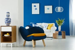 Up-to-date decor of blue and white lounge with sofa and armchair