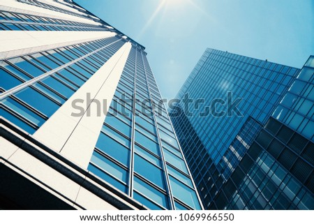 Up to see modern skyscrapers in the city with beautiful sky and sunshine.        #1069966550