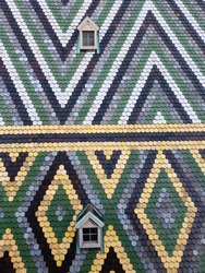 Upclose texture of geometric tiles on a church roof in Vienna Austria