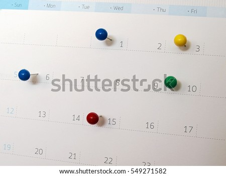 Upcoming events. Calendar with thumbtacks as a concept of events #549271582