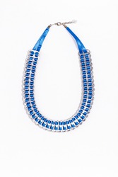 Upcycled blue necklace made out of soda can tabs and threaded with fine ribbon isolated on a white background. Creative reuse of post-consumer waste