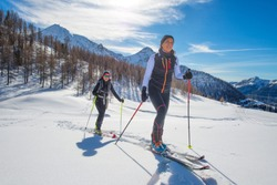 Uphill women with seal skins and ski mountaineering.