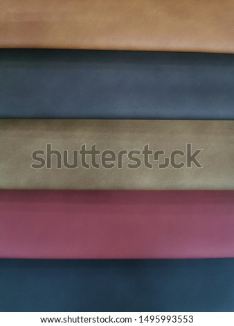Upholstery sample materials with different shades and colors for manufacturing sofa, couches and beds.  #1495993553