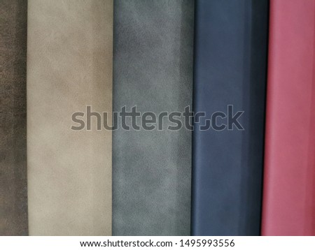 Upholstery sample materials with different shades and colors for manufacturing sofa, couches and beds.  #1495993556