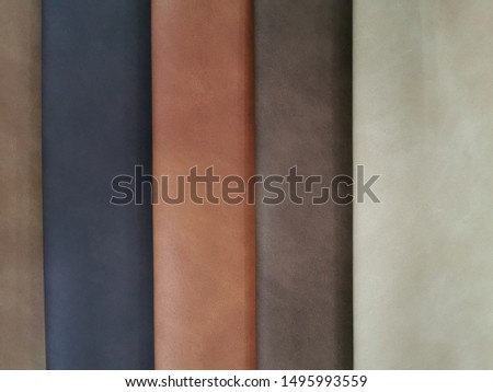 Upholstery sample materials with different shades and colors for manufacturing sofa, couches and beds.  #1495993559