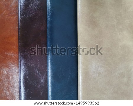 Upholstery sample materials with different shades and colors for manufacturing sofa, couches and beds.  #1495993562